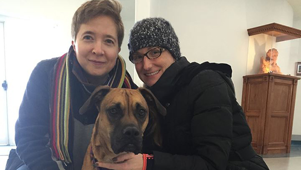 women with brown dog at Perfect Pet Resort